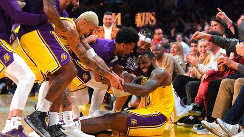 <p>               Los Angeles Lakers forward LeBron James I swarmed by teammates after making several 3-point shots in a row during the second half of the team's NBA basketball game against the San Antonio Spurs on Tuesday, Feb. 4, 2020, in Los Angeles. (AP Photo/Mark J. Terrill)             </p>