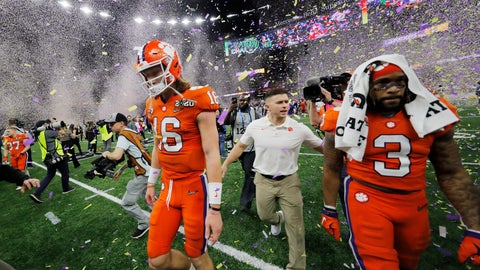 <p>               Clemson quarterback Trevor Lawrence, left, leaves the field after a NCAA College Football Playoff national championship game against LSU, Monday, Jan. 13, 2020, in New Orleans. LSU won 42-25.(AP Photo/Gerald Herbert)             </p>