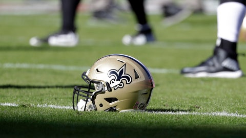 <p>               FILE - In this Oct. 23, 2016, file photo, a New Orleans Saints helmet rests on the playing field before an NFL football game in Kansas City, Mo. An Associated Press review of public tax documents found that the Bensons' foundation has given at least $62 million to the Archdiocese of New Orleans and other Catholic causes over the past dozen years, including gifts to schools, universities, charities and individual parishes.  (AP Photo/Jeff Roberson, File)             </p>