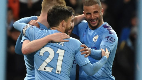 <p>               Manchester City's Kevin De Bruyne, left, is congratulated by teammates after scoring his team's second goal during the English Premier League soccer match between Manchester City and West Ham at Etihad stadium in Manchester, England, Wednesday, Feb. 19, 2020. (AP Photo/Rui Vieira)             </p>