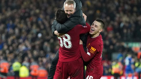 <p>               Liverpool's Under 23 coach Neil Critchley, center, celebrates with Liverpool's Pedro Chirivella and Liverpool's Adam Lewis, right, after winning the English FA Cup Fourth Round replay soccer match between Liverpool and Shrewsbury Town at Anfield Stadium, Liverpool, England, Tuesday, Feb. 4, 2020. Liverpool won 1-0. (AP Photo/Jon Super)             </p>