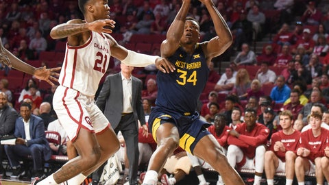 <p>               West Virginia guard Oscar Tshiebwe (34) goes up for a shot ahead of Oklahoma forward Kristian Doolittle (21) during the first half of an NCAA college basketball game in Norman, Okla., Saturday, Feb. 8, 2020. (AP Photo/Kyle Phillips)             </p>