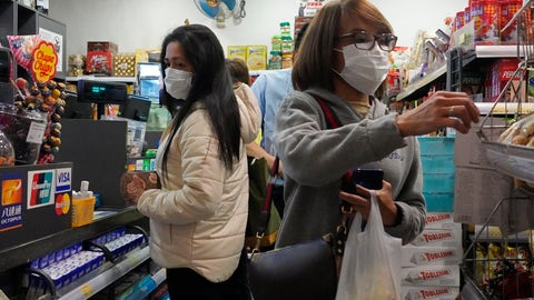 <p>               People wear protective face masks as they make purchases from a convenience store in Hong Kong, Monday, Feb, 3, 2020. Hong Kong leader Carrie Lam in a Monday press conference says the city will shut almost all land and sea border control points to the mainland from midnight to stem the spread of the novel coronavirus from China. (AP Photo/Vincent Yu)             </p>