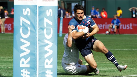 <p>               FILE - In this July 21, 2018, file photo, United States' Madison Hughes scores in front of England's Alex Davis during the Rugby Sevens World Cup in San Francisco. The World Rugby Sevens Series and the U.S. Eagles are back in Los Angeles for the first time in 14 years. (AP Photo/Jeff Chiu, File)             </p>