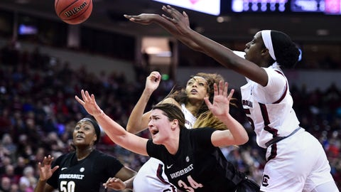 <p>               Vanderbilt forward Mariella Fasoula (34) is fouled attempting a shot against South Carolina forward Laeticia Amihere, right, and Mikiah Herbert Harrigan, left, during the first half of an NCAA college basketball game Monday, Feb. 17, 2020, in Columbia, S.C. (AP Photo/Sean Rayford)             </p>