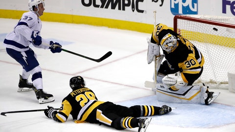 <p>               Tampa Bay Lightning's Yanni Gourde (37) puts the game-winning goal past Pittsburgh Penguins goaltender Matt Murray (30) with Marcus Pettersson (28) defending during the overtime period of an NHL hockey game in Pittsburgh, Tuesday, Feb. 11, 2020. The Lightning won in overtime 2-1. (AP Photo/Gene J. Puskar)             </p>