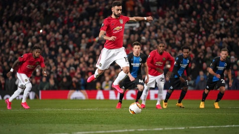 <p>               Manchester United's Bruno Fernandes, center, scores his side's opening goal from the penalty spot during the round of 32 second leg Europa League soccer match between Manchester United and Brugge at Old Trafford in Manchester, England, Thursday, Feb. 27, 2020. (AP Photo/Dave Thompson)             </p>