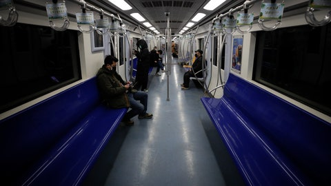 <p>               Commuters ride in a quiet subway train during the morning rush hour in Beijing, Monday, Feb. 17, 2020. Chinese authorities on Monday reported a slight upturn in new virus cases and hundred more deaths for a total of thousands since the outbreak began two months ago. (AP Photo/Andy Wong)             </p>