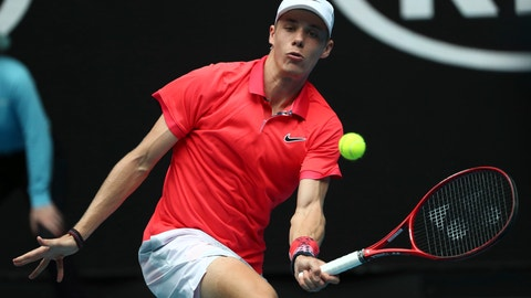 <p>               Canada's Denis Shapovalov makes a forehand return to Hungary's Marton Fucsovics during their first round singles match the Australian Open tennis championship in Melbourne, Australia, Monday, Jan. 20, 2020. (AP Photo/Dita Alangkara)             </p>