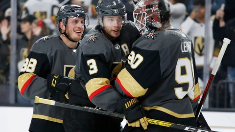 <p>               Vegas Golden Knights defenseman Nate Schmidt, left, defenseman Brayden McNabb (3) and Robin Lehner (90) celebrate after defeating the Buffalo Sabres in an NHL hockey game Friday, Feb. 28, 2020, in Las Vegas. (AP Photo/John Locher)             </p>