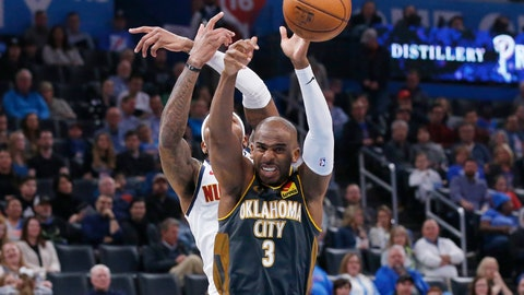 <p>               Oklahoma City Thunder guard Chris Paul (3) reaches for a rebound with Denver Nuggets forward Torrey Craig, rear, in the first half of an NBA basketball game Friday, Feb. 21, 2020, in Oklahoma City. (AP Photo/Sue Ogrocki)             </p>