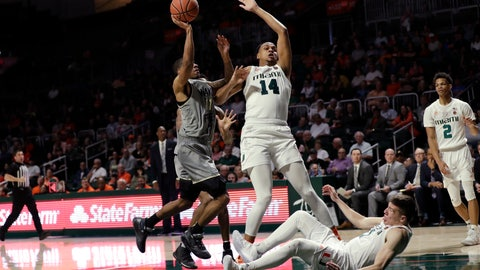<p>               Wake Forest guard Torry Johnson (11) goes up for a shot against Miami center Rodney Miller Jr. (14) and guard Dejan Vasiljevic (1) during the second half of an NCAA college basketball game, Saturday, Feb. 15, 2020, in Coral Gables, Fla. Miami defeated Wake Forest 71-54. (AP Photo/Wilfredo Lee)             </p>