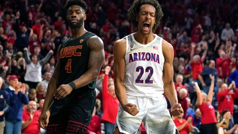 <p>               Arizona forward Zeke Nnaji (22) reacts after dunking next to Southern California guard Daniel Utomi during the second half of an NCAA college basketball game Thursday, Feb. 6, 2020, in Tucson, Ariz. Arizona won 85-80 (AP Photo/Rick Scuteri)             </p>