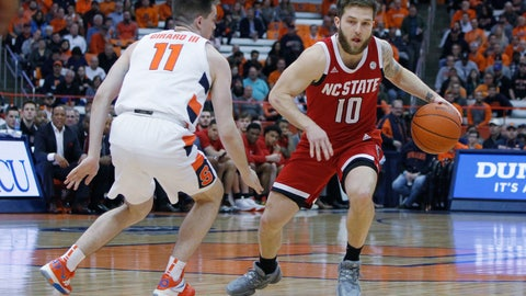 <p>               North Carolina State's Braxton Beverly, right, tries to dribble past Syracuse's Joseph Girard III, left, in the first half of an NCAA college basketball game in Syracuse, N.Y., Tuesday, Feb. 11, 2020. (AP Photo/Nick Lisi)             </p>