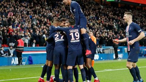 <p>               PSG players celebrate after Edinson Cavani scored their fourth goal during the League One soccer match between Paris Saint Germain and Lyon at the Parc des Princes stadium in Paris, Sunday, Feb. 9, 2020. (AP Photo/Thibault Camus)             </p>