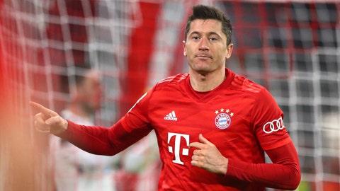 <p>               Bayern's Robert Lewandowski celebrates after scoring his side's fourth goal during the German soccer cup, DFB Pokal, match between FC Bayern Munich and TSG Hoffenheim in Munich, Germany, Wednesday, Feb. 5, 2020. (AP Photo/Matthias Schrader)             </p>