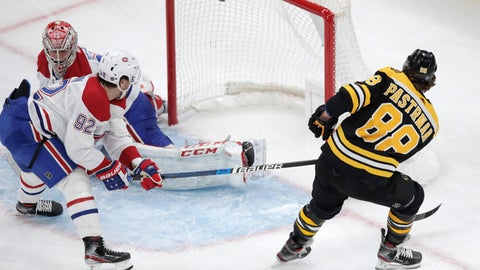 <p>               Boston Bruins right wing David Pastrnak (88) scores on Montreal Canadiens goaltender Carey Price during the first period of an NHL hockey game in Boston, Wednesday, Feb. 12, 2020. At left is Montreal Canadiens left wing Jonathan Drouin (92). (AP Photo/Charles Krupa)             </p>