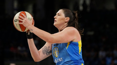 <p>               FILE - In this Aug. 16, 2019, file photo, Chicago Sky's Stefanie Dolson shoots during the first half of the team's WNBA basketball game against the Los Angeles Sparks in Chicago. It's been a busy week for Dolson. She was part of the NBA All-Star festivities this past weekend in Chicago as well as being selected to the USA Basketball 3-on-3 qualifying team. The All-Star center also re-signed with the Sky. The free agent said that she never considered going anywhere else and always wanted to stay in Chicago. (AP Photo/Charles Rex Arbogast, File)             </p>