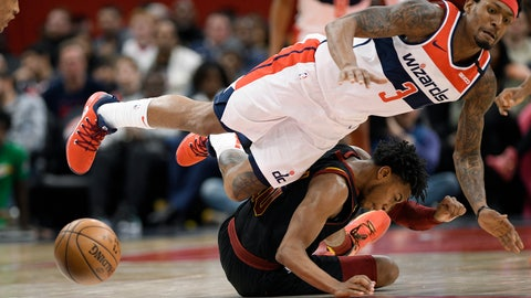 <p>               Cleveland Cavaliers guard Darius Garland, bottom, and Washington Wizards guard Bradley Beal are unable to come up with the ball during the second half of an NBA basketball game Friday, Feb. 21, 2020, in Washington. Garland was called for a foul on the play. The Cavaliers won 113-108. (AP Photo/Nick Wass)             </p>