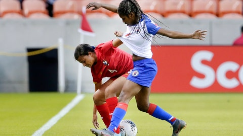 <p>               Panama defender Hilary Jaen (4) grabs the jersey of Haiti forward Batcheba Louis (7) as they battle for the ball during the first half of a CONCACAF women's Olympic qualifying soccer match Monday, Feb. 3, 2020, in Houston. (AP Photo/Michael Wyke)             </p>