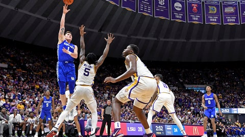 <p>               Kentucky forward Nate Sestina (1) shoots over LSU forward Emmitt Williams (5) as LSU forward Darius Days (0) watches during the first half of an NCAA college basketball game Tuesday, Feb. 18, 2020, in Baton Rouge, La. (AP Photo/Bill Feig)             </p>