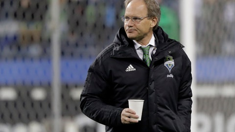 <p>               Seattle Sounders coach Brian Schmetzer walks on the field before a CONCACAF Champions League soccer match against Olimpia, Thursday, Feb. 27, 2020, in Seattle. The match ended with a 2-2 tie for a 4-4 aggregate score in the two-game series; Olimpia won on penalty kicks to advance to the next round. (AP Photo/Ted S. Warren)             </p>