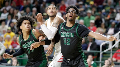 <p>               Dayton's Obi Toppin, center, positions for a free throw as George Mason's Javon Greene, left, and AJ Wilson defend during the second half of an NCAA college basketball game, Tuesday, Feb. 25, 2020, in Fairfax, Va. Dayton won 62-55. (AP Photo/Luis M. Alvarez)             </p>