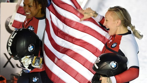 <p>               Kaillie Humphries, right, and Lauren Gibbs of the US celebrate after winning the two-woman bobsled competition at the Bobsleigh and Skeleton World Championships in Altenberg, Germany, Saturday, Feb. 22, 2020. (AP Photo/Jens Meyer)             </p>