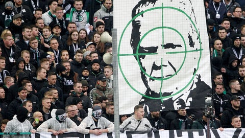 <p>               Supporters of Moenchengladbach show a banner with the portrait of Dietmar Hopp during the German Bundesliga soccer match between Borussia Moenchengladbach and TSG Hoffenheim in Moenchengladbach, Germany, Saturday, Feb. 24, 2020. Borussia Mönchengladbach supporters were the center of attention for targeting Hoffenheim's billionaire backer Dietmar Hopp with crude abusive messages during their sides' Bundesliga game on Saturday. It led to a suspension in play, but their actions were quickly condemned by fellow fans before the game could be called off. ( Roland Weihrauch/dpa via AP)             </p>