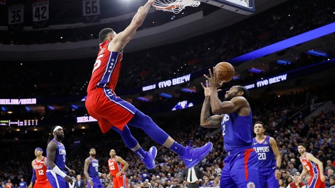 <p>               Philadelphia 76ers' Ben Simmons, left, dunks the ball against Los Angeles Clippers' Kawhi Leonard during the second half of an NBA basketball game, Tuesday, Feb. 11, 2020, in Philadelphia. (AP Photo/Matt Slocum)             </p>