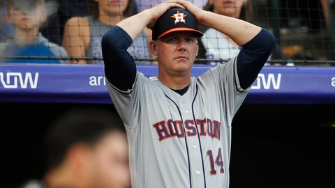 <p>               FILE - In this July 2, 2019, file photo, Houston Astros manager AJ Hinch reacts during a baseball game against the Colorado Rockies, in Denver. Houston  manager AJ Hinch and general manager Jeff Luhnow were suspended for the entire season Monday, Jan. 13, 2020,  and the team was fined $5 million for sign-stealing by the team in 2017 and 2018 season. Commissioner Rob Manfred announced the discipline and strongly hinted that current Boston manager Alex Cora — the Astros bench coach in 2017 — will face punishment later. Manfred said Cora developed the sign-stealing system used by the Astros. (AP Photo/David Zalubowski, File)             </p>