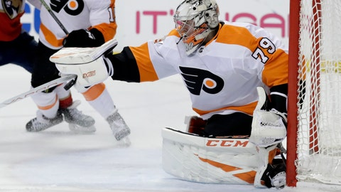 <p>               Philadelphia Flyers goaltender Carter Hart stops the puck during the first period of the team's NHL hockey game against the Florida Panthers, Thursday, Feb. 13, 2020, in Sunrise, Fla. (AP Photo/Lynne Sladky)             </p>