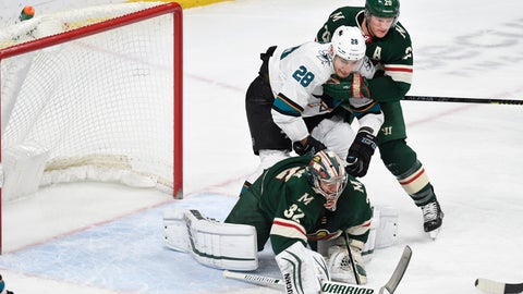<p>               Minnesota Wild's Ryan Suter, right, holds off the San Jose Sharks' Timo Meier (28), of Switzerland, as the Wild's goalie Alex Stalock makes a save in the first period of an NHL hockey game, Saturday, Feb. 15, 2020, in St. Paul, Minn. (AP Photo/Tom Olmscheid)             </p>