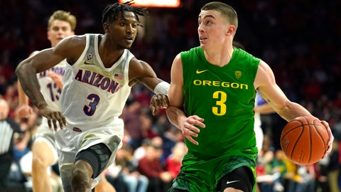 <p>               Oregon guard Payton Pritchard, right, drives on Arizona guard Dylan Smith during the first half of an NCAA college basketball game Saturday, Feb. 22, 2020, in Tucson, Ariz. (AP Photo/Rick Scuteri)             </p>