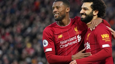<p>               Liverpool's Mohamed Salah, right, celebrates with Liverpool's Georginio Wijnaldum after scoring his sides third goal during the English Premier League soccer match between Liverpool and Southampton at Anfield Stadium, Liverpool, England, Saturday, February 1, 2020. (AP Photo/Jon Super)             </p>