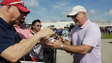 <p>               Washington Nationals general manager Mike Rizzo, right, signs autographs for fans during spring training baseball practice Friday, Feb. 14, 2020, in West Palm Beach, Fla. (AP Photo/Jeff Roberson)             </p>
