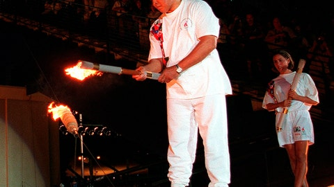 <p>               FILE - In this July 19, 1996, file photo, Muhammad Ali, is watched by U.S. swimmer Janet Evans as he lights the Olympic flame during the 1996 Summer Olympic Games opening ceremony in Atlanta. The Olympic cauldron used in the 1996 Games in Atlanta is scheduled to be publicly lit again for the first time in over two decades on Saturday, Feb. 29, 2020. (AP Photo/Michael Probst, File)             </p>