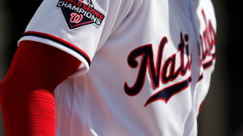 <p>               Washington Nationals pitcher Patrick Corbin wears a World Series Champions patch on his jersey while throwing a bullpen session during spring training baseball practice Monday, Feb. 17, 2020, in West Palm Beach, Fla. The Nationals defeated the Houston Astros in the World Series last season. (AP Photo/Jeff Roberson)             </p>