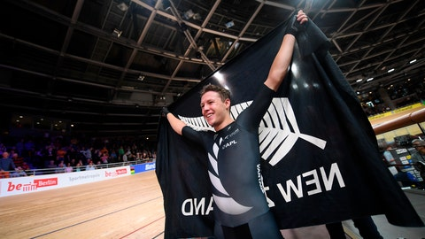 <p>               Corbin Strong from New Zealand cheers after his victory in the Men's 40 km points race during the Cycling World Championship in Berlin, Germany, Friday Feb. 28, 2020. (Sebastian Gollnow/dpa via AP)             </p>