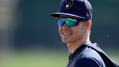 <p>               Milwaukee Brewers infielder Brock Holt looks on during spring training baseball Wednesday, Feb. 19, 2020, in Phoenix. Holt and the Brewers finalized a one-year contract Wednesday, a deal that includes a team option for 2021. (AP Photo/Gregory Bull)             </p>