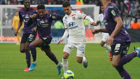 <p>               Lyon's Houssem Aouar, center, controls the ball during the French League One soccer match between Lyon and Toulouse in Decines, outside Lyon, central France, Sunday, Jan. 26, 2020. (AP Photo/Laurent Cipriani)             </p>