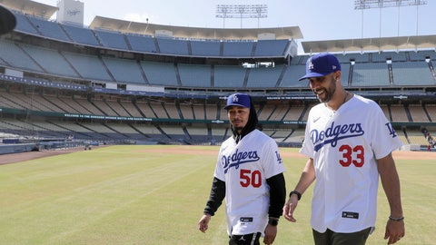 <p>               New Los Angeles Dodgers players David Price, right, and Mookie Betts walk after a news conference to announce their acquisition at Dodger Stadium in Los Angeles, Wednesday, Feb. 12, 2020. (AP Photo/Chris Carlson)             </p>