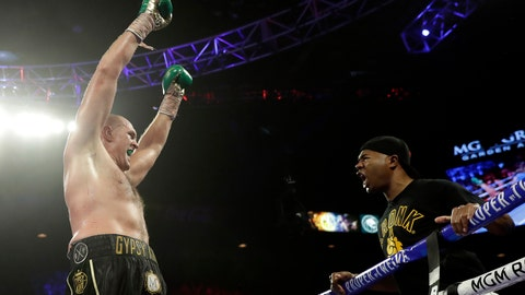 "<p>               Tyson Fury, left, of England approaches his trainer Javon ""SugarHill"" Steward after defeating Deontay Wilder in a WBC heavyweight championship boxing match Saturday, Feb. 22, 2020, in Las Vegas. (AP Photo/Isaac Brekken)             </p>"