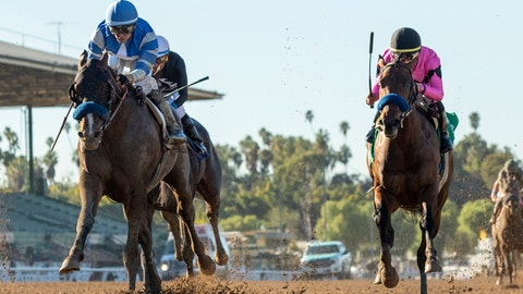 <p>               In a photo provided by Benoit Photo, Thousand Words and jockey Flavien Prat, left, win the Grade III $200,000 Robert B. Lewis Stakes horse race, giving trainer Bob Baffert his 3,000th win, Saturday, Feb. 1, 2020, at Santa Anita in Arcadia, Calif. (Benoit Photo via AP)             </p>