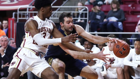 <p>               Boston College guard Jared Hamilton (3) tries to stop Notre Dame forward John Mooney, right, on a drive to the basket during the first half of an NCAA men's college basketball game in Boston, Wednesday, Feb. 26, 2020. (AP Photo/Charles Krupa)             </p>