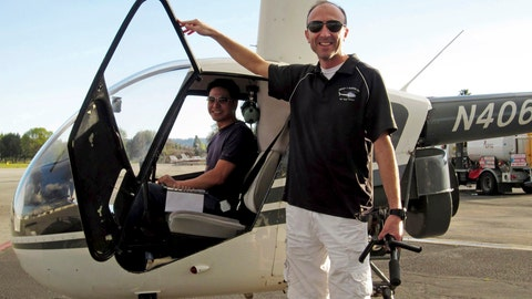 <p>               FILE - This undated file photo provided by Group 3 Aviation shows helicopter pilot Ara Zobayan standing outside a helicopter, at a location not provided. Zobayan violated federal flight rules in 2015 when he flew into busy airspace near Los Angeles International Airport despite being ordered not to by air traffic control, according to records from the Federal Aviation Administration obtained by the Los Angeles Times. (Group 3 Aviation via AP, File)             </p>
