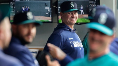 <p>               FILE - In this April 12, 2019 file photo, Seattle Mariners manager Scott Servais, center, smiles in the dugout before a baseball game against the Houston Astros in Seattle. Spring training for the Mariners ahead of the 2020 season will feature young players and prospects that could be at the heart of whether the Mariners' rebuild plans ultimately work. (AP Photo/Ted S. Warren, File)             </p>