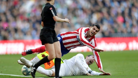 <p>               Atletico Madrid's Alvaro Morata, above, is tackled by Real Madrid's Sergio Ramos during a Spanish La Liga soccer match between Real Madrid and Atletico Madrid at the Santiago Bernabeu stadium in Madrid, Saturday, Feb. 1, 2020. (AP Photo/Bernat Armangue)             </p>