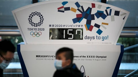 <p>               FILE - In this Tuesday, Feb. 18, 2020, file photo, people wearing masks sit in front of a countdown clock for the Tokyo 2020 Olympics in Tokyo. The Tokyo Olympics open in exactly five months on July 24. But the fast-spreading coronavirus from China is making Tokyo organizers very anxious. Three deaths have been reported in Japan with more than 700 cases, more than 600 from a cruise ship that docked in Japan. (AP Photo/Jae C. Hong, File)             </p>