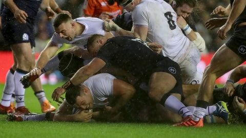 <p>               England's Ellis Genge, bottom left, scores a try in Storm Ciara during the Six Nations rugby union international match between Scotland and England at Murrayfield Stadium, in Edinburgh, Scotland, Saturday, Feb. 8, 2020. (AP Photo/Scott Heppell)             </p>